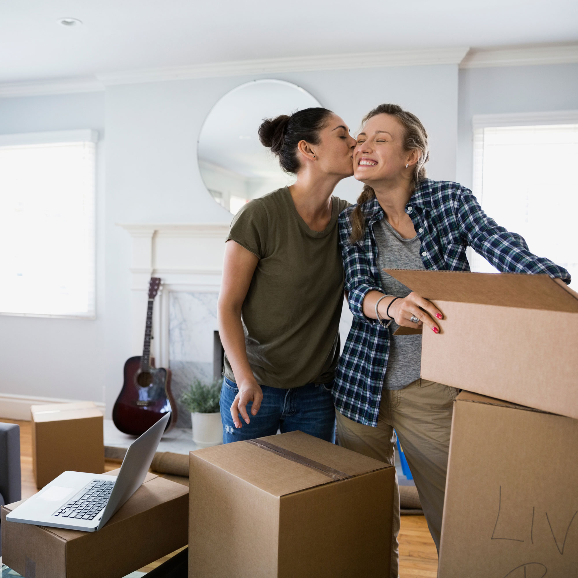 Women Couple with moving boxes.